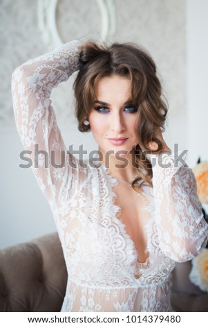 sexy lady in white lace lingerie