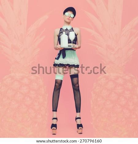 Sexy lady Waitress. Glamorous party style. Vanilla Pineapple background - stock photo