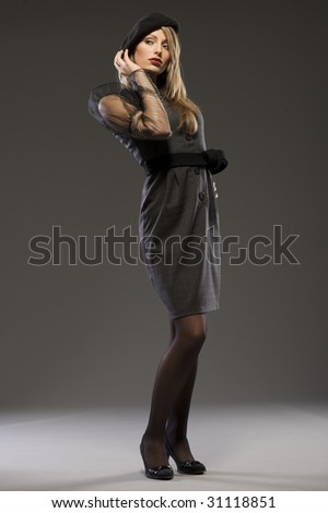 sexy lady wearing grey dress on grey background