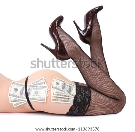 sexy legs and dollars isolated on white - stock photo