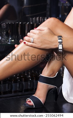 Sexy legs, fashion sandals,luxury watch and diamond ring - stock photo