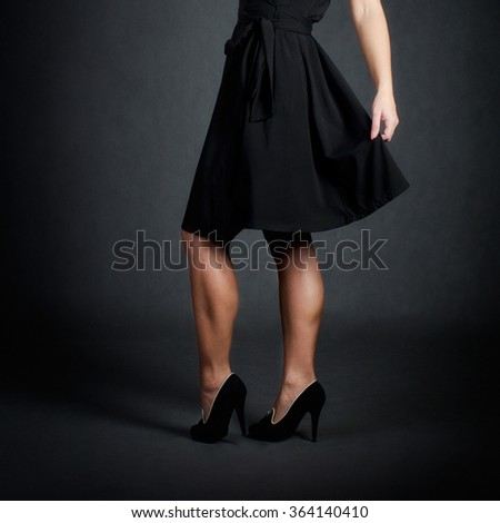 Sexy legs in high heels and skirt - stock photo