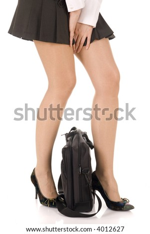 sexy legs in high heels shoes and briefcase between (ready for voyage) isolated on white background. Studio shot, professional model, perfect for travel agency - stock photo