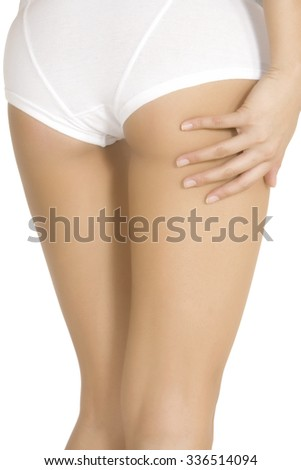 Sexy legs of a young caucasian woman isolated on a white background