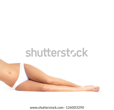 Sexy legs of young beautiful woman isolated on white - stock photo