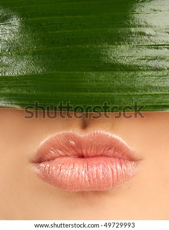 sexy lips and green leaf - stock photo