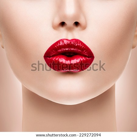 Sexy Lips. Beauty Red Lip Makeup Detail. Beautiful Make-up Closeup. Sensual Open Mouth. lipstick or Lipgloss. Kiss. Beauty Model Woman's Face close-up  - stock photo