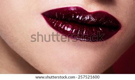 Sexy Lips. Beauty Red Lips Makeup Detail. Beautiful Make-up Closeup. lipstick or Lipgloss - stock photo