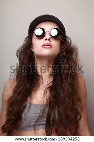 Sexy long hair woman in fashion sun glasses and cap - stock photo