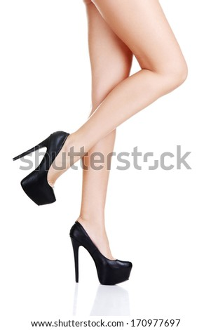 Sexy long woman's leg and high heel shoes ,isolated on white