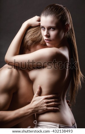 Sexy love couple on a dark background