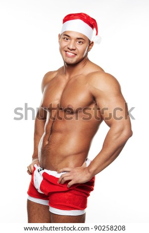 Sexy male posing in xmas costume, isolated on white - stock photo