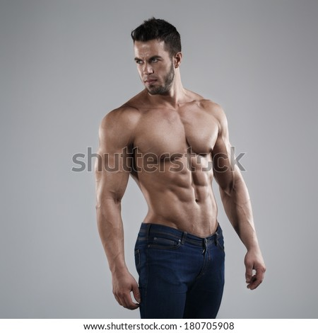 Sexy man in studio  - stock photo