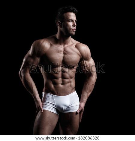 Sexy man in studio - stock photo
