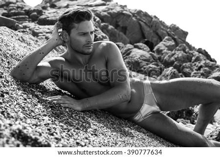 Sexy Man In Underwear Posing On The Beach - stock photo