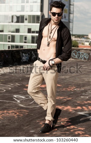 sexy man model unbuttoned shirt looking serious full body - stock photo