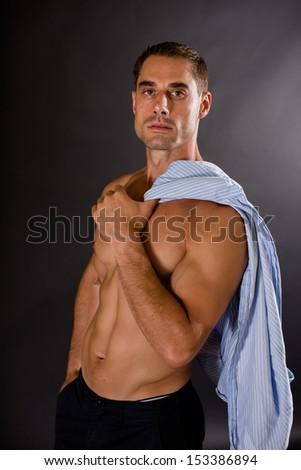 Sexy Man on Dark Background - stock photo