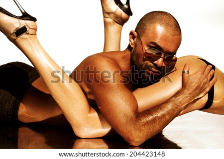 Sexy man on naked woman - stock photo