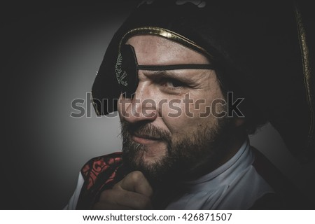 Sexy man pirate with eye patch and old hat with funny faces and expressive