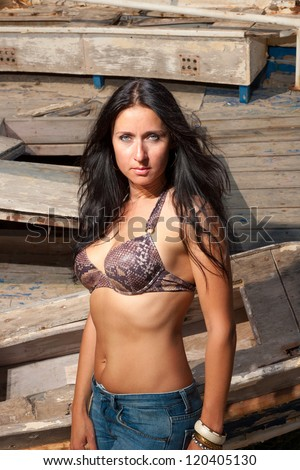 Sexy mature model posing at shipwreck