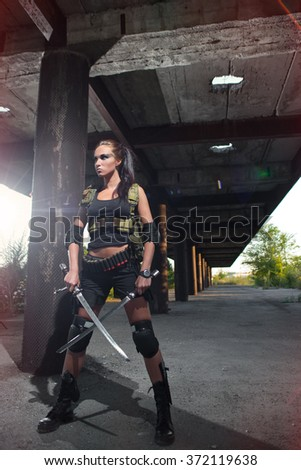 sexy military armed girl with the blades - stock photo