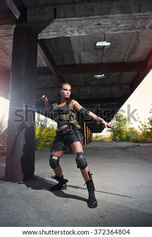 sexy military armed girl with the weapon - stock photo