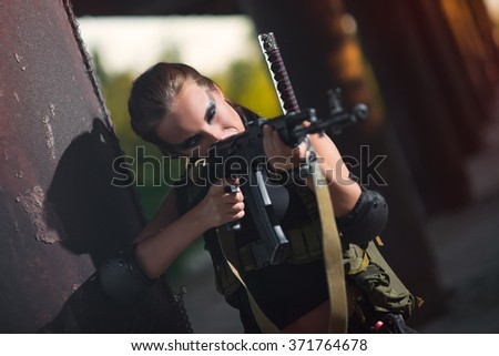 sexy military armed girl with the weapon, sniper - stock photo