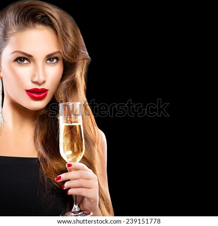 Sexy model girl with glass of champagne at party, drinking champagne over holiday glowing background. Beauty woman with perfect fashion makeup. Christmas and New Year holiday celebration  - stock photo