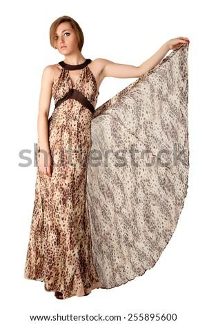 Sexy model in animal print long dress. - stock photo