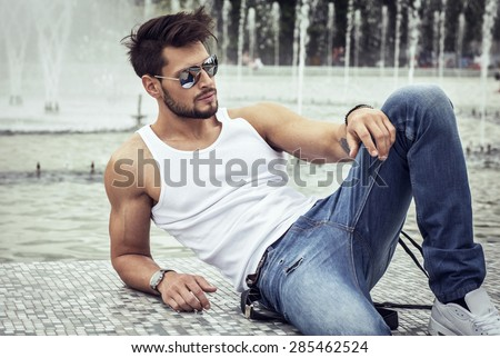 Sexy model in aviator sunglasses - stock photo