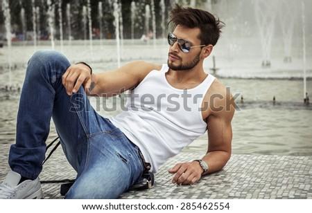 Sexy model in aviator sunglasses - stock photo