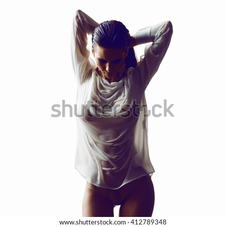 Sexy model in wet t-shirt - stock photo