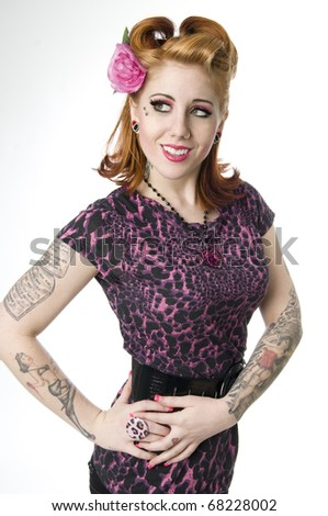 Sexy model wearing animal print and flower in hair - stock photo