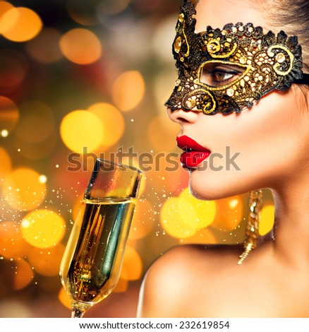Sexy model woman with glass of champagne wearing venetian masquerade mask at party, drinking champagne over holiday glowing background. Christmas and New Year celebration. Perfect make up - stock photo