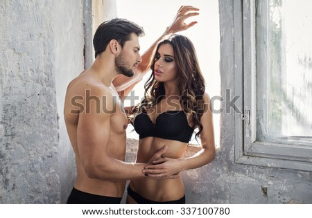 Sexy models touching each other - stock photo