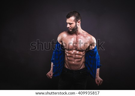 Sexy muscular male model posing in studio.