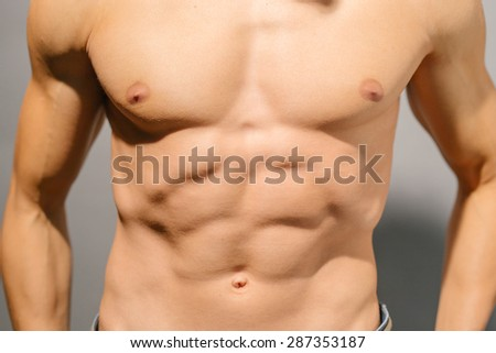 Sexy muscular male torso , close-up