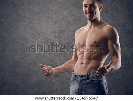 Sexy muscular man thumbs up