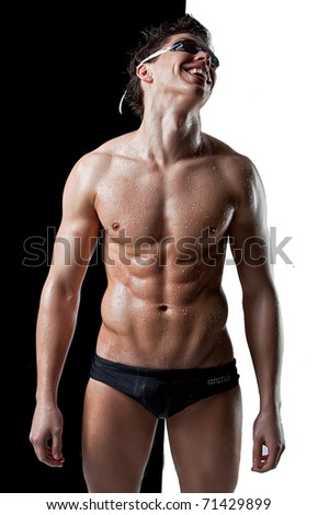 Sexy muscular wet swimmer with glasses smile - stock photo