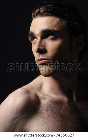 sexy muscular young male man against black background - stock photo