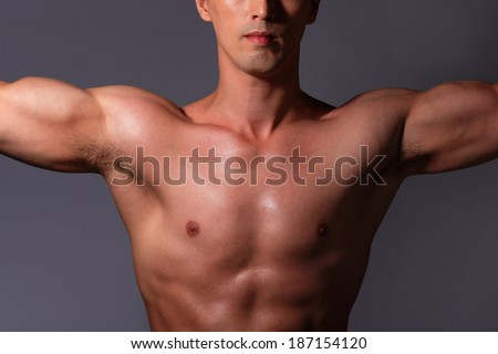http://thumb1.shutterstock.com/display_pic_with_logo/870799/187154120/stock-photo-sexy-muscular-young-man-isolated-on-gray-background-asian-and-european-mixed-blood-187154120.jpg