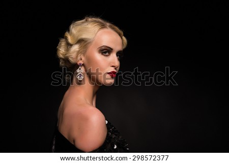 Sexy, mysterious girl on black. Makeup retro, vintage. Hairstyle in the style of the 20s