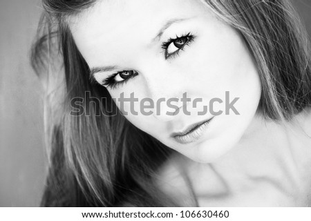 Sexy mysterious young woman's portrait in black and white - closeup