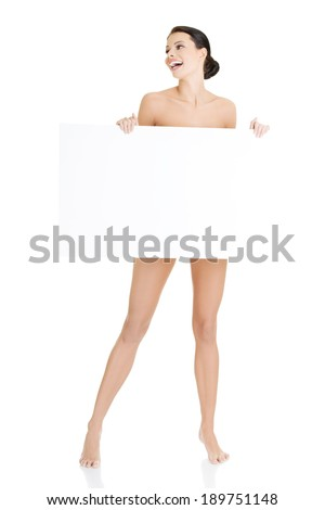 Sexy naked brunette holding empty board , isolated on white. - stock photo