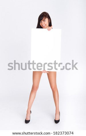 Sexy naked girl holding a blank board for text - stock photo