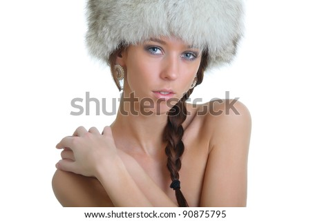 Sexy naked girl in a fur hat