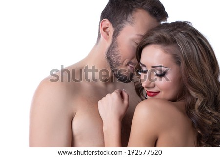 Sexy naked girl shyly hiding in arms of lover - stock photo