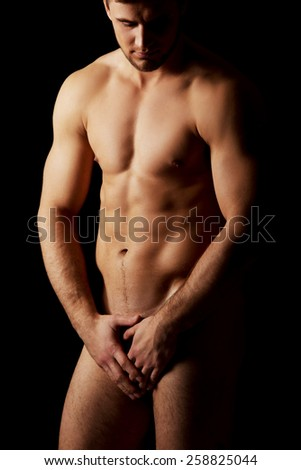 Sexy naked muscular macho man. - stock photo