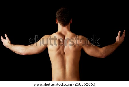Sexy naked muscular man showing his muscular back. - stock photo