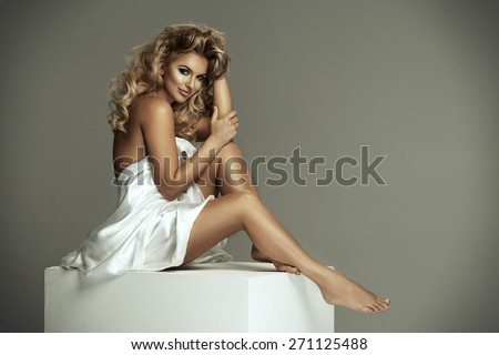 Sexy naked woman in white fabric - stock photo